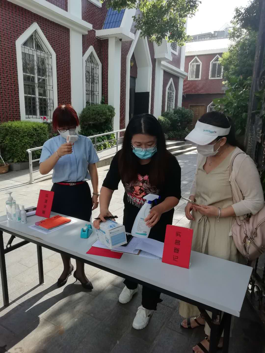 Co-workers were measuring body temperature, wearing masks, showing health codes, and doing registration work.