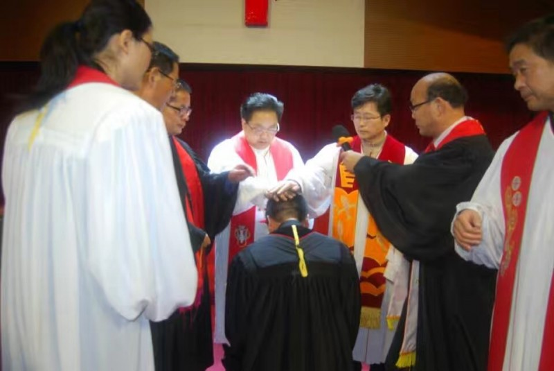 the-ordination-team-ordains-a-co-worker