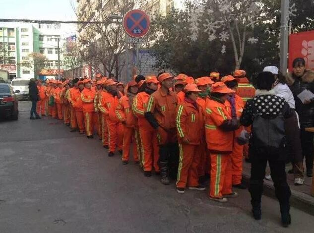 the-urban-sanitation-workers-wait-in-line-to-get-boxed-lunch