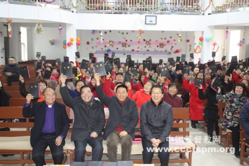 rev-shan-left-3-in-the-first-row-holds-the-bible-with-the-congregation-in-gujiaxiang-church