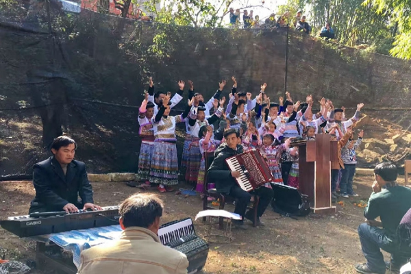 The Miao choir sings hymns to praise God and some brothers play instruments
