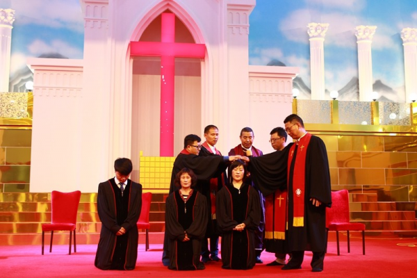 The two pastors and one teachers were ordained in the church on May 1, 2017