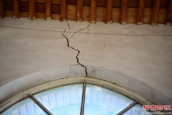 Several cracks in one side of the church walls