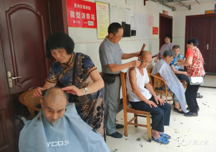 On July 19, 2020, local believers cut the hair of elderly residents whp live in a nursing home in Yuanzhou District, Yichun, China's southern Jiangxi Province.