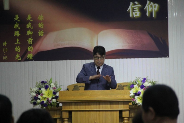 Rev. Ming Dasheng preaced a Sunday sermon in sign language in 2019.