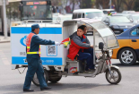 A policeman stopping an express delivery tricycle in China.