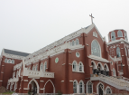 Sister Li dedicates a red ceramic tile for the  construction of the international chapel of The Northeast Theological Seminary as an ornament for the church's facade.