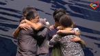 The people on the stage hug each other to comfort the broken heart of overseas Chinese