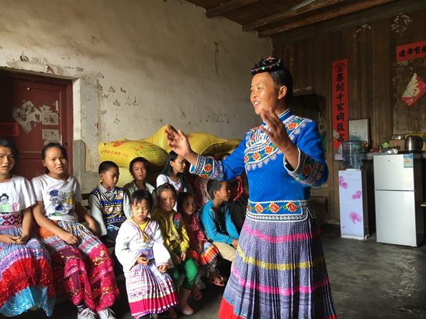 A leader of a church choir of Miao people leads the believers to sing hymns