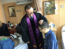 Liu Yang receives the baptism in the hospital