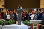 The commissioned believers for new campuses are praying, led by Rev. Wu Weiqing.