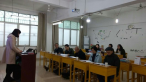 the teacher in the Jiangxi Provincial Bible School is giving a lecture.