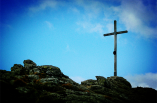 A cross stands on the stone.