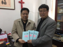 Rev. Mao Yajun, vice-president and vice-chairman Tianjin CCC&TSPM, and Rev.Wang Yujiu hold the manuscripts of the New Testament