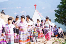 Miao Christians walked up the mountain to attend the dedication ceremony