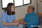 A volunteer talked with an elderly leprosy survivor.