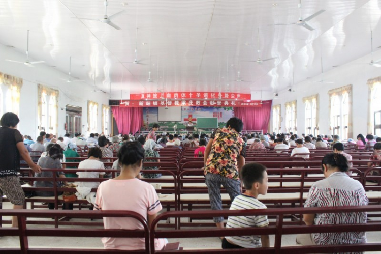Before a rural church of Zhoukou held a service.