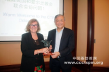 Christine Elliott received a gift from Elder Fu Xianwei.