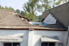 Seen from the outside:a part of the tiled roof collapsed.