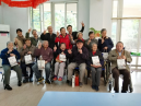 Group photo: the elderly received presents from the church with happiness.