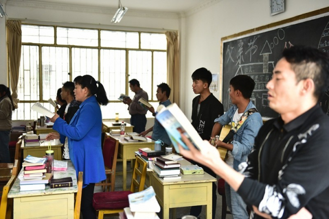 Some of the school's students sing hymns.
