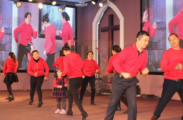 Qibao Abundance Church in Shanghai:Christian families performed a rhythm dance.