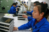 Staff in Amity Printing Company are working on new Bibles.