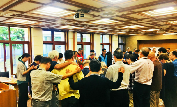 The participants of the fifth Annual Christian Forum for Reconciliation in Northeast Asia prayed together.