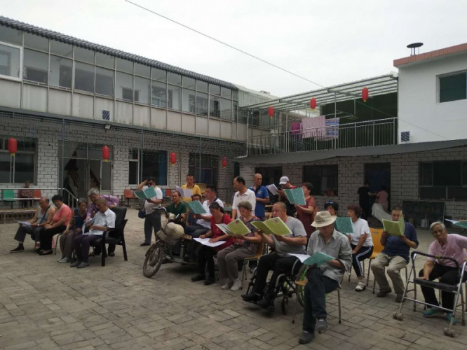 The nursing home's residents sang hymns with the volunteers on June 16, 2018.