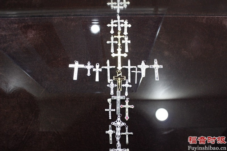 A large cross made of small ones