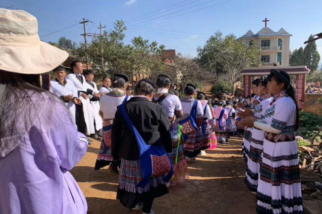 Miao believers walked to the church while other members stood in two lines to welcome them.