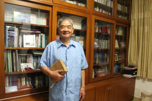 Rev Chen Yiping, 89, at his study room holding the Bible that accompanied him during his 20 years of corrective labour from 1958-78.