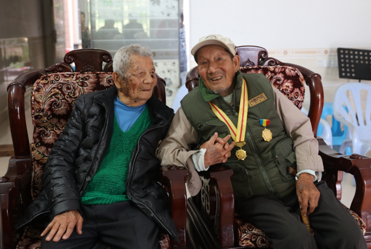 Zhuang Yuanfang met He Shuncong in Dongkeng Village, Pinghe, Fujian, on April 19, 2019.