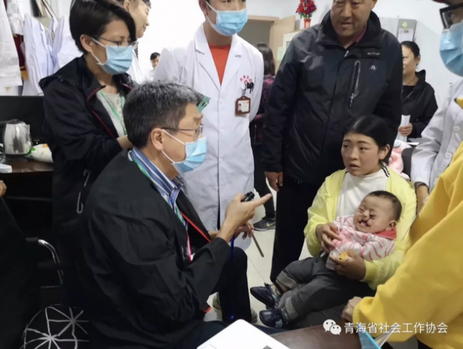 A doctor from HK Cornerstone Association examined a boy with a cleft lip before the surgery on April 21, 2019.