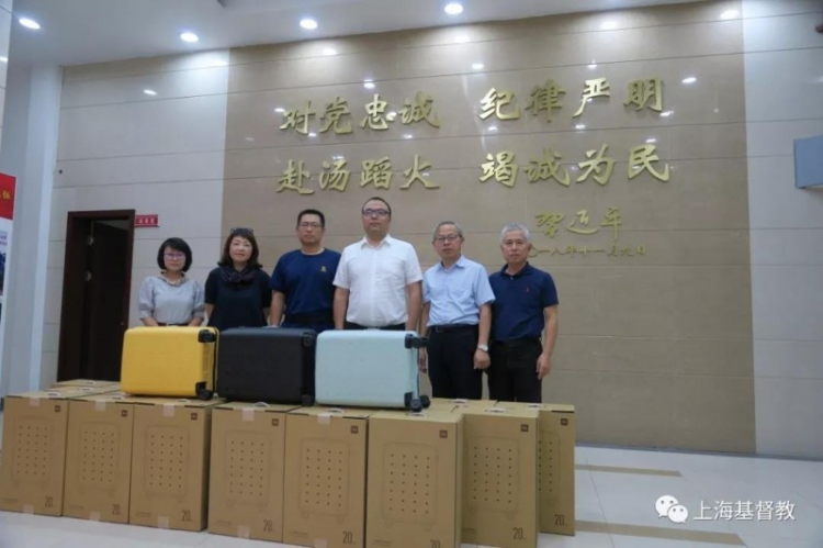 The firemen squadron of the Bund in Shanghai received gifts from Shanghai Pure Heart Church on Aug 14, 2019.