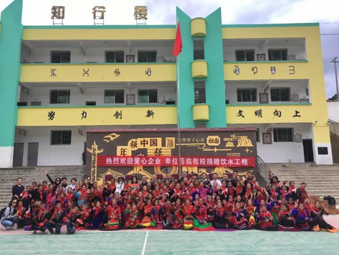 The 23-strong team from Sichuan churches and a foundation with the students and staff of Luji Central School