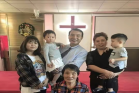 Pastor Yu's family and his two adopted children, Tian'en and Tianxin