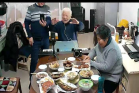 The 94-year-old Elder Yuan Xiangzhong in Fenghua District of Ningbo City, Zhejiang Province led the family to do thanksgiving prayers before dinner on February 10, 2021.
